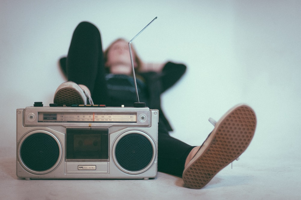 Listening to music is a form of relaxation, which can calm pre-presentation anxiety and help you stay grounded.