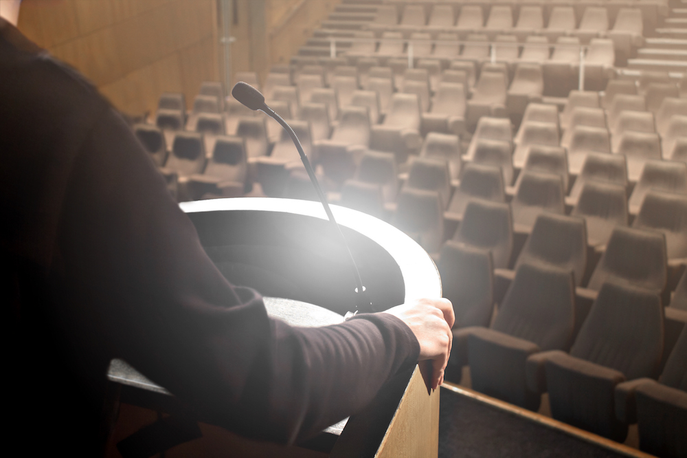 Practice is an essential part of speech preparation. Image of a presenter practicing their keynote without an audience.