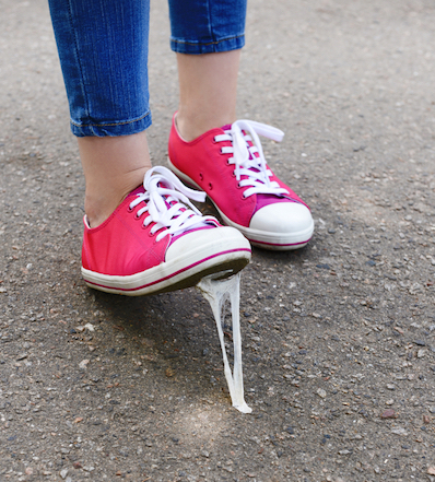 Not taking the stage because you're stuck procrastinating. Shoe stuck in chewing gum visual analogy